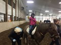 A student rides a horse at Fieldstone Farm.