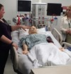 Students learn about patient care using simulators.