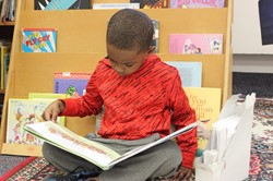 Kindergarten student reading a book