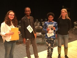 Three spelling bee participants with teacher