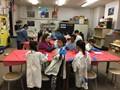 Noble Peer-to-Peer students painting