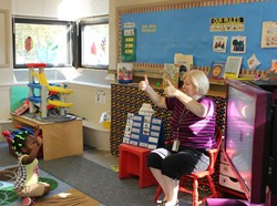 A Gearity Preschool teacher and her student give a thumb's up