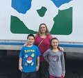 Jessica Wright and her children in front of the mobile unit
