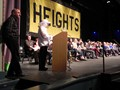 Spelling bee participants on stage in 2015