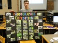 Student with photography poster