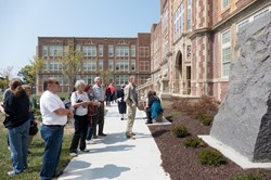 Visitors gathering in the courtyard during the Heights High Grand Opening.
