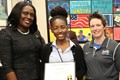 Yidiayah Box (center) was honored at a Board of Education meeting in September.