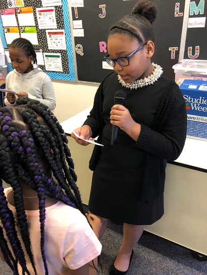 Female student performing living wax museum speech