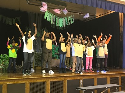 Students on stage performing Jungle Book
