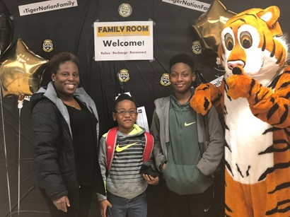 HMS family with the tiger mascot