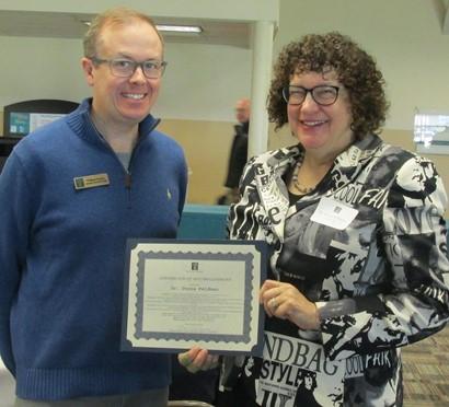 Dr. Donna Feldman with associate dean and award