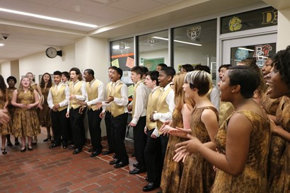 Men and women singers rehearsing at Heights High