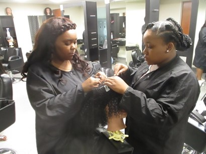 Cleveland Heights High School students in Donna Pollard's cosmetology classes are making wigs for cancer patients. Shown here are two of those students, seniors Larrian Redmond, left, and Taijah Watkins, both of Cleveland Heights. (Jeff Piorkowski/special