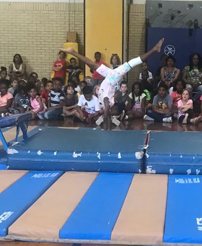 Girl doing gymnastics routine on mat