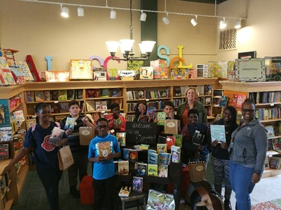 Group of students with books in bookstore