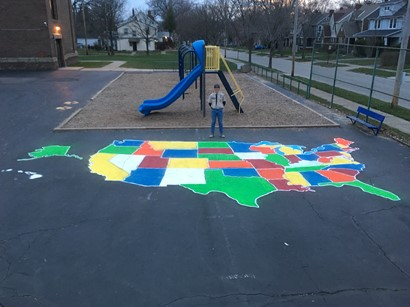 Dylan Polley with playground map of u.s.