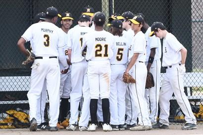 Heights High baseball players huddle