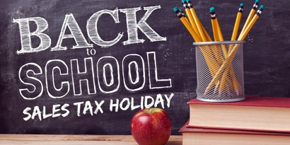 Sales Tax Holiday on chalkboard with pencils and apple