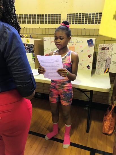 Girl reading script dressed as Gabby Douglas
