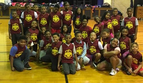 Kids in basketball jerseys
