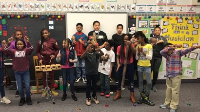 Music class kids playing instruments