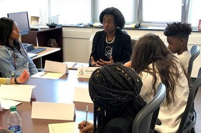 Elizabeth Kirby with Heights Middle School students