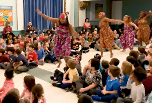 students watching african dance
