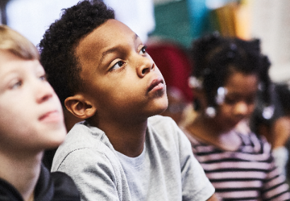 students listening to teacher speak