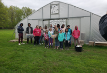 kids in front of greenhouse