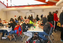 students and parents eating at tables