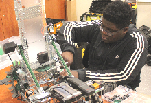 Student working on robot