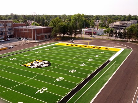 Heights High Athletic Field Turf  Laying Completed Aug. 7, 2014