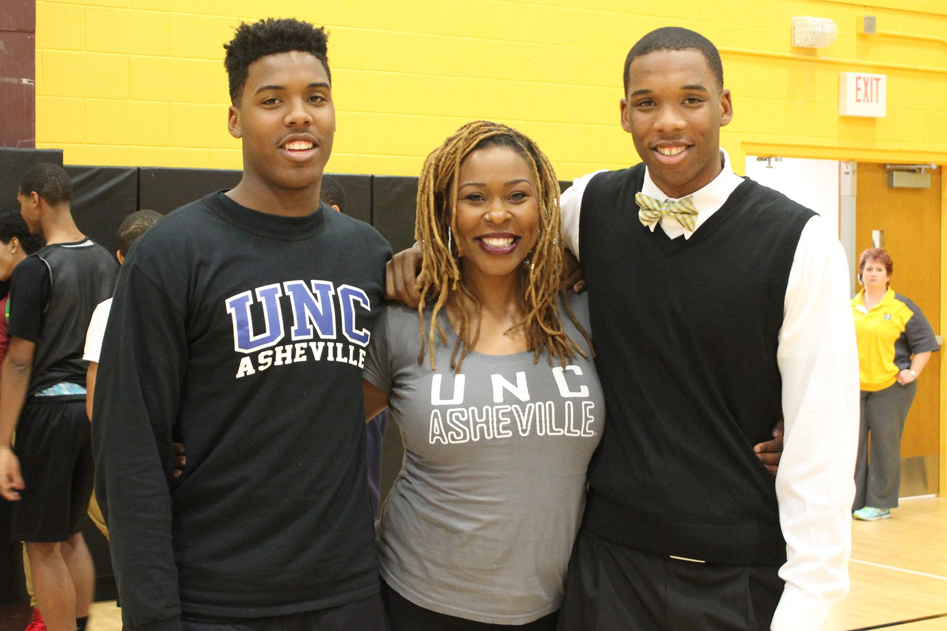 Malik Smith with his brother Tyreke and mother Michelle.