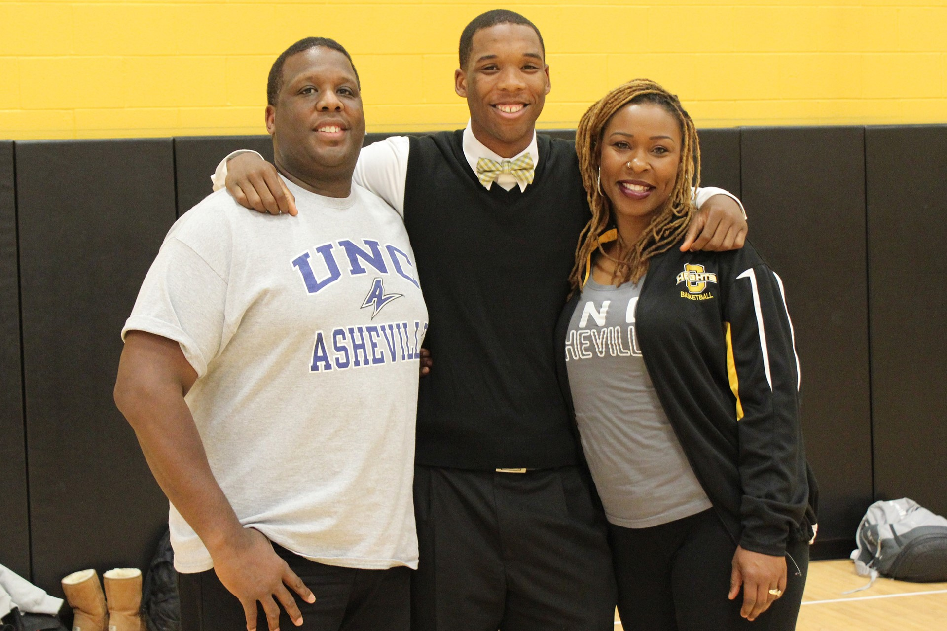 Malik Smith with his parents Randy and Michelle Smith.