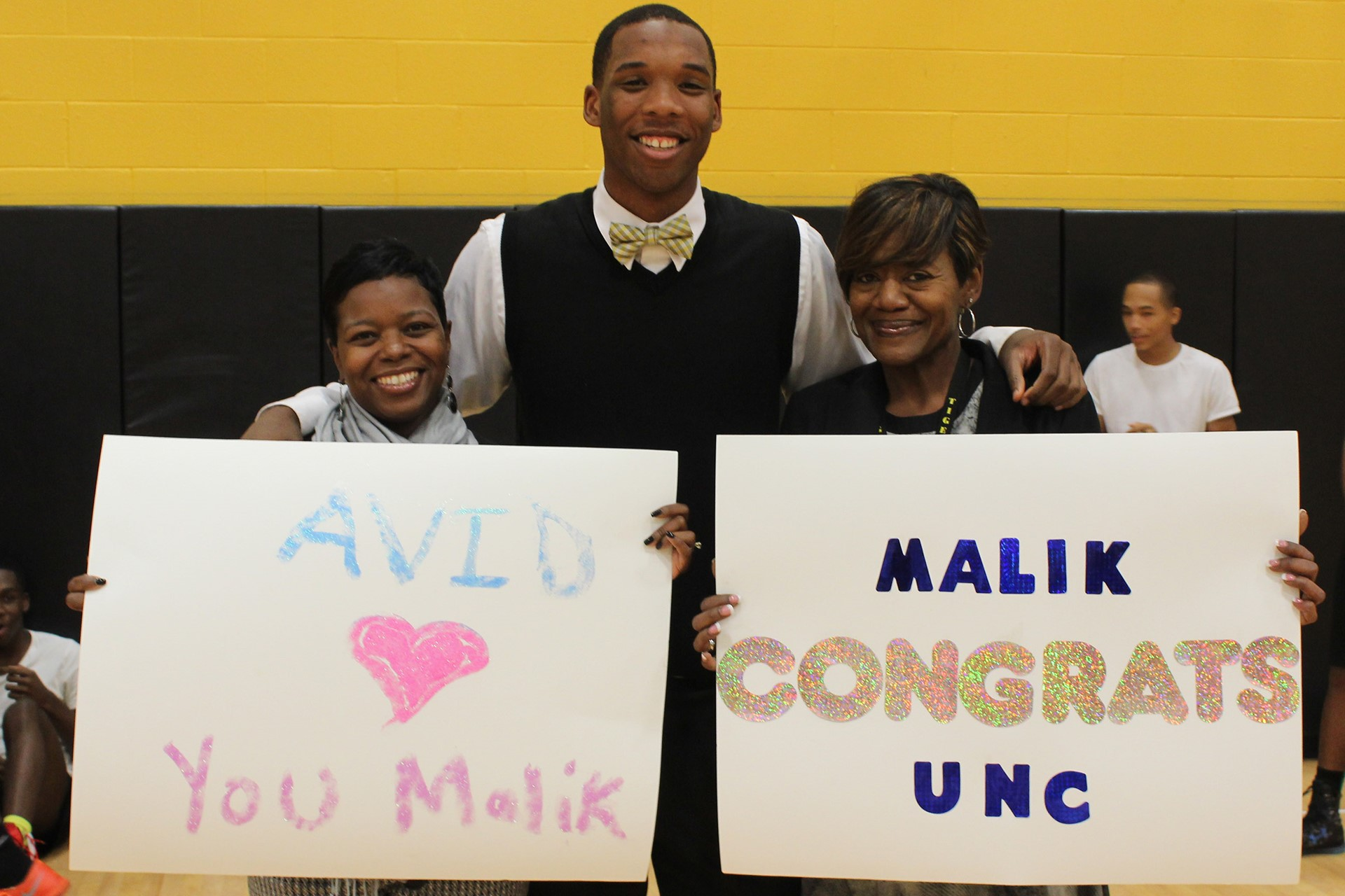 Malik Smith with teachers Shawn Washington and Claudene McCoy.