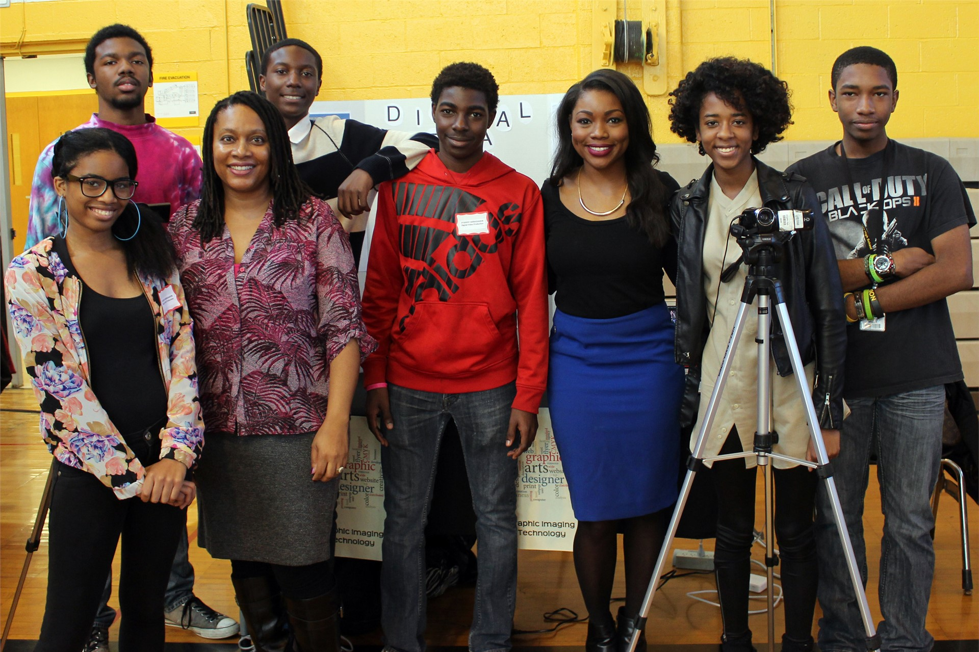 Shanice Dunning with the Digital Video Production class and teacher Cynthia Barnes.