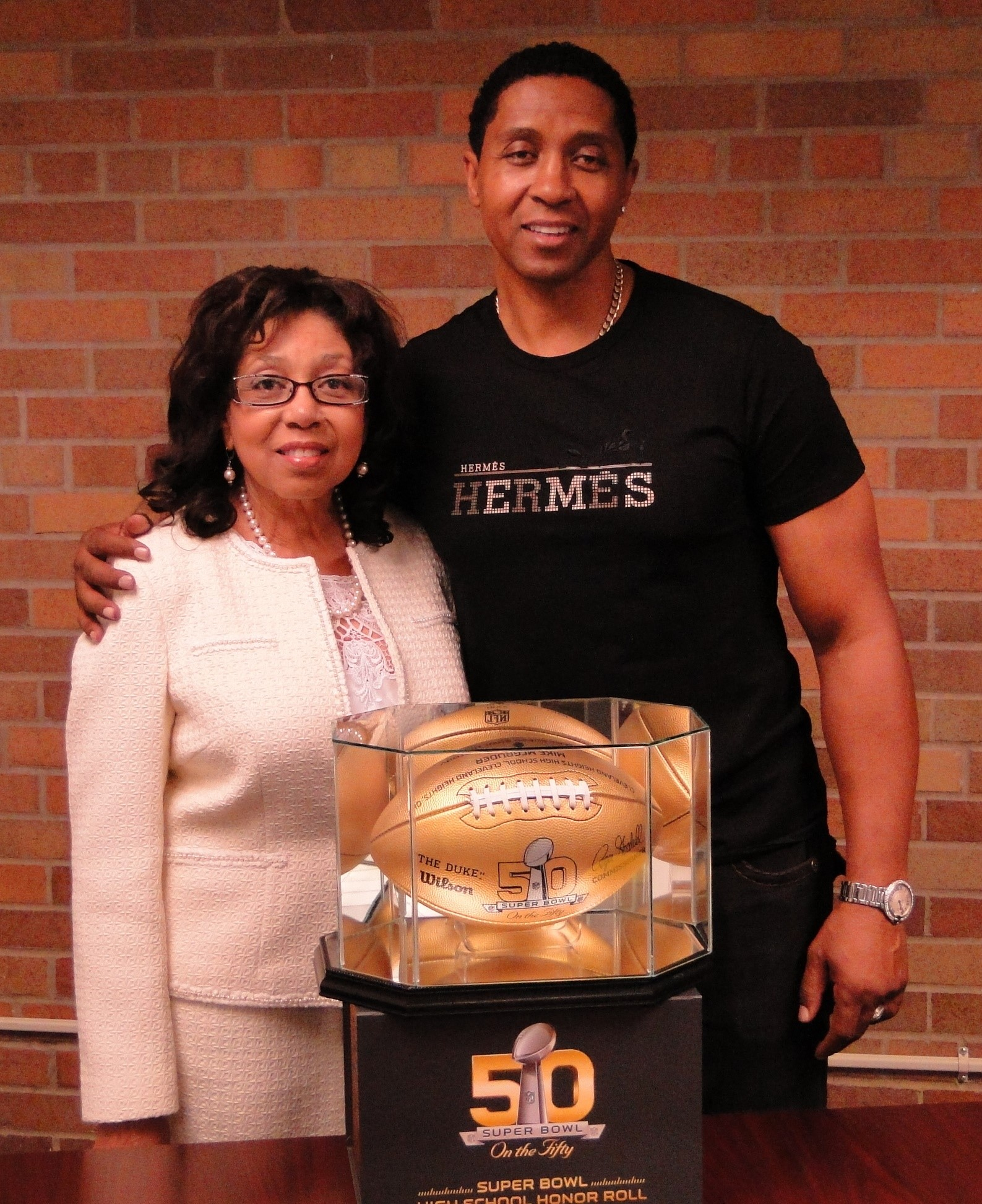 Mike McGruder and his mother, Marian Wallace, retired Glenville principal..