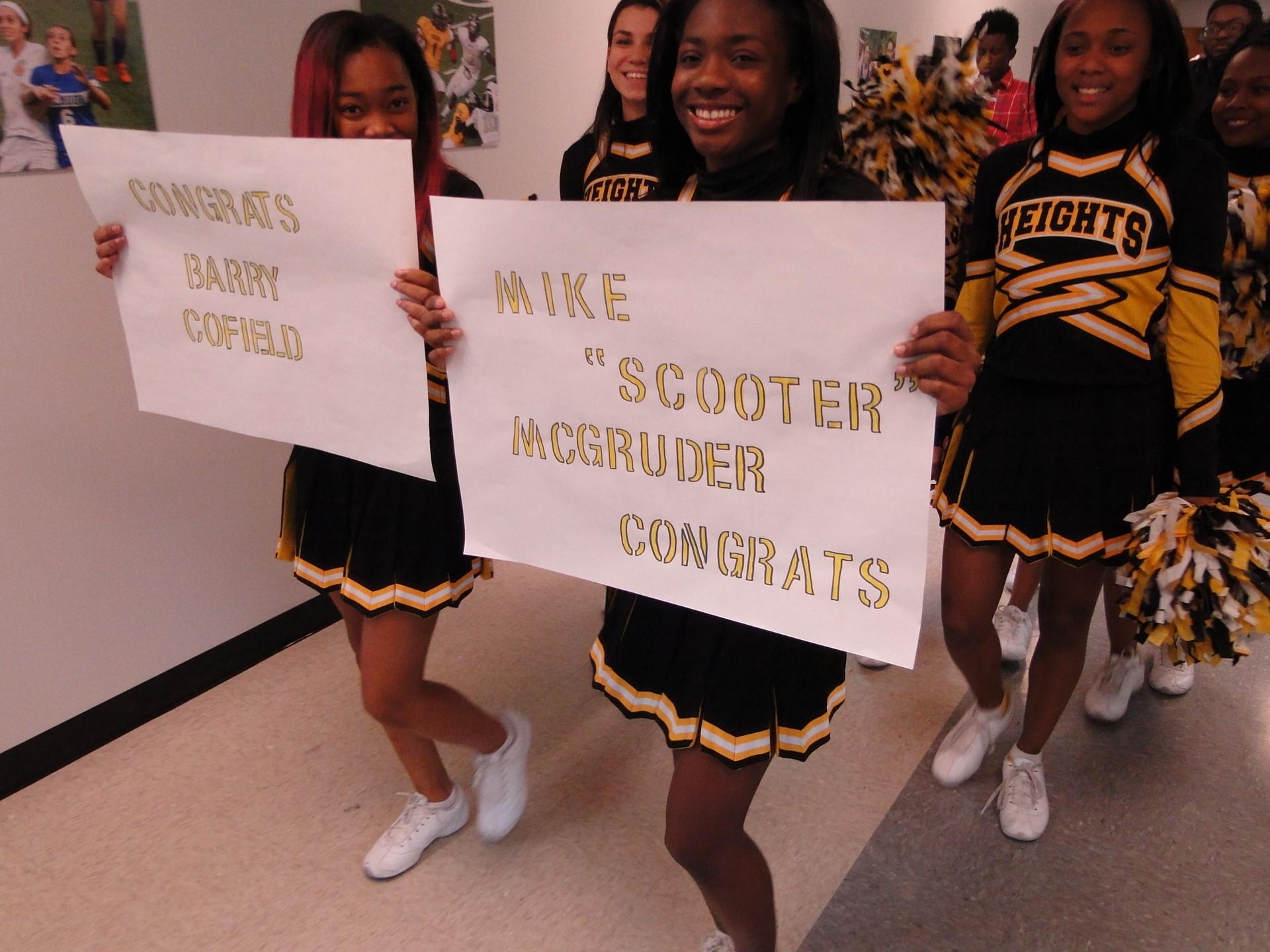 Cheerleaders lead the parade