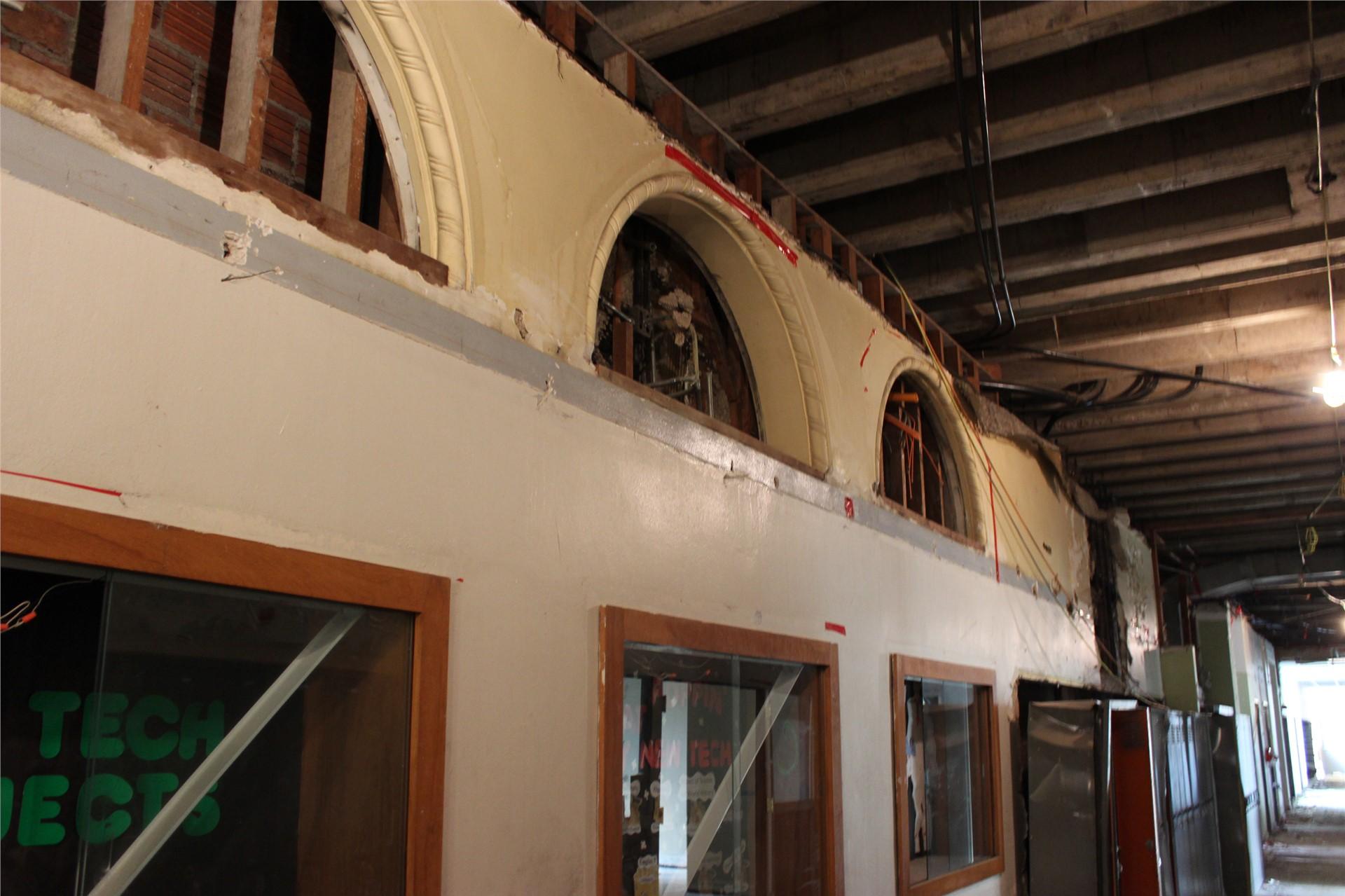 Plaster details were revealed above ceiling on third floor hallway