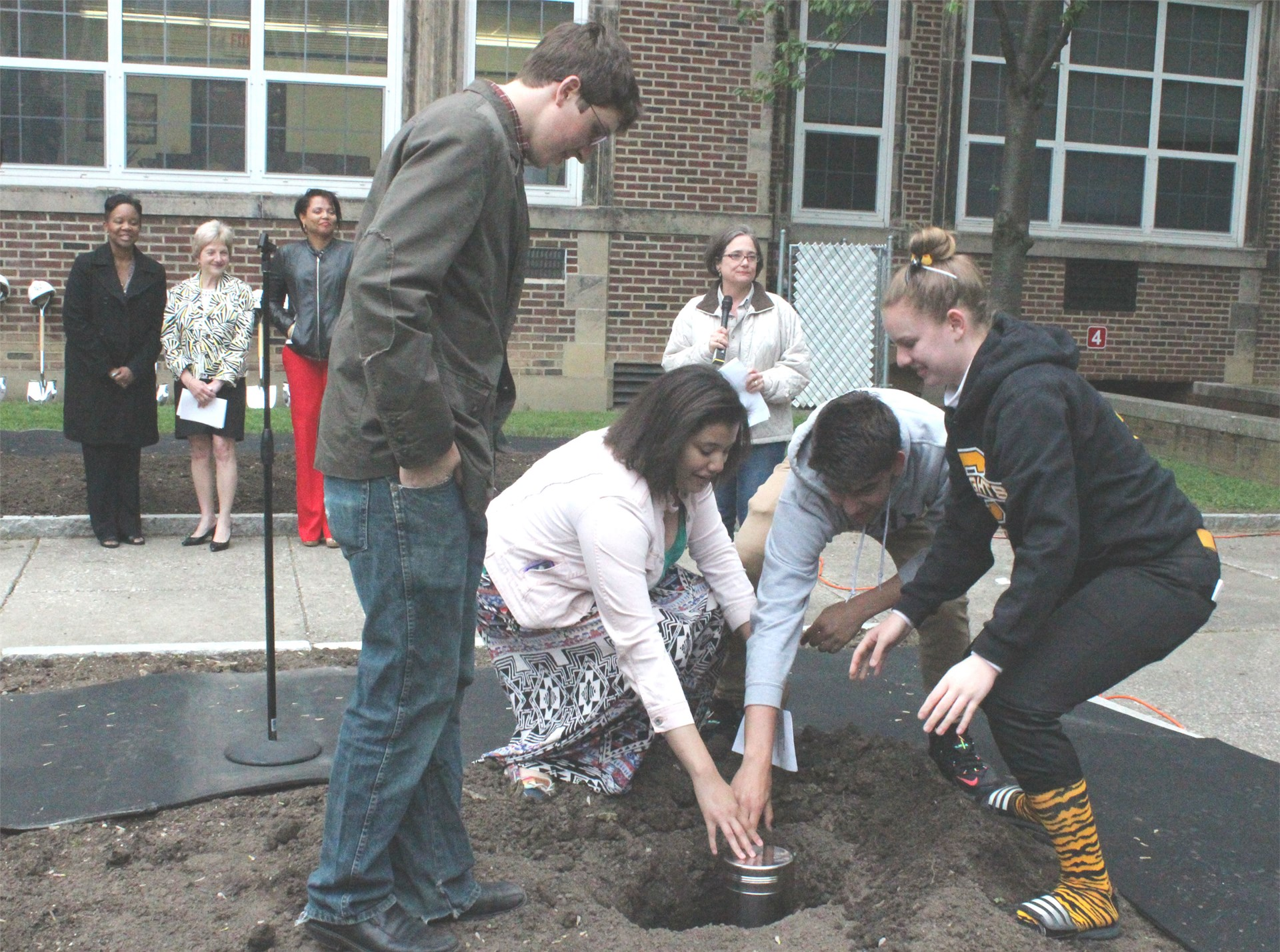 Small Schools ambassadors place time capsule in the ground