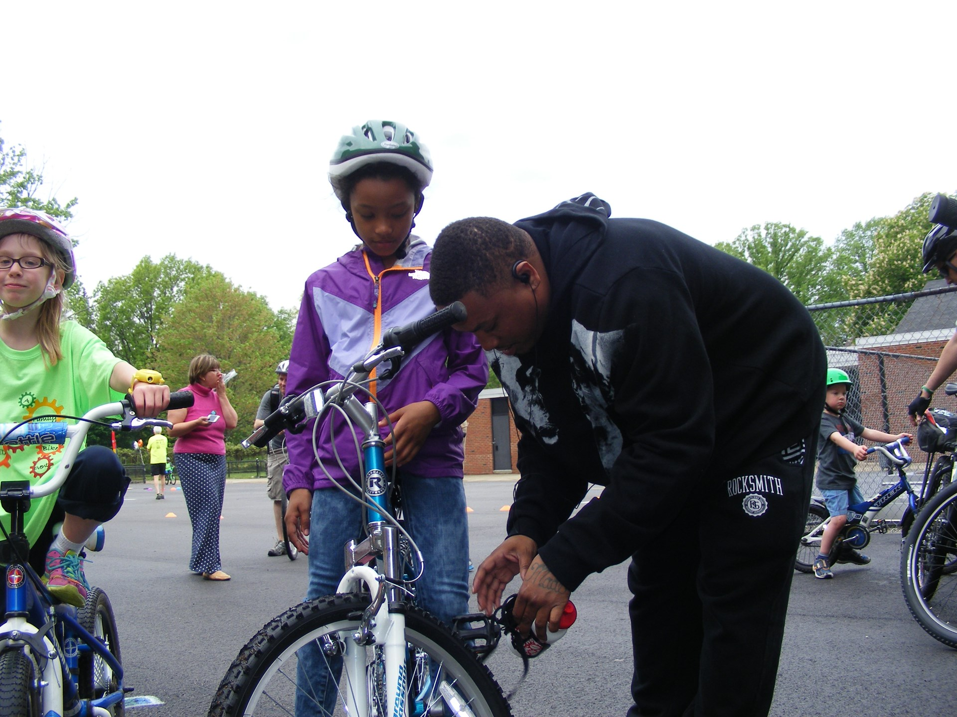 Dad fixes a bike before the activities