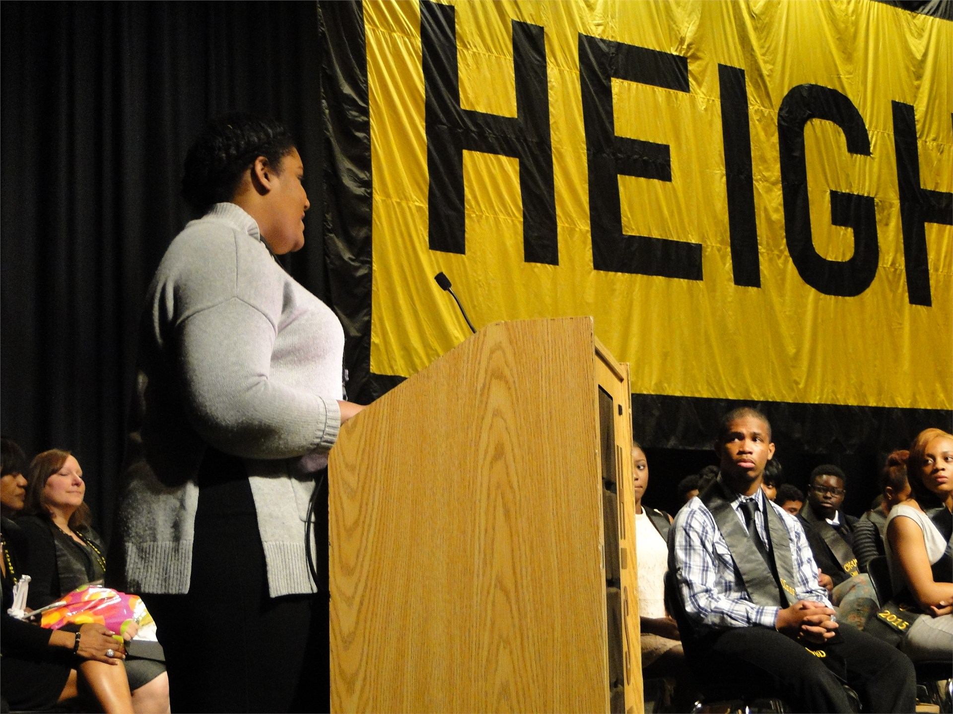 A junior AVID student addresses the senior class