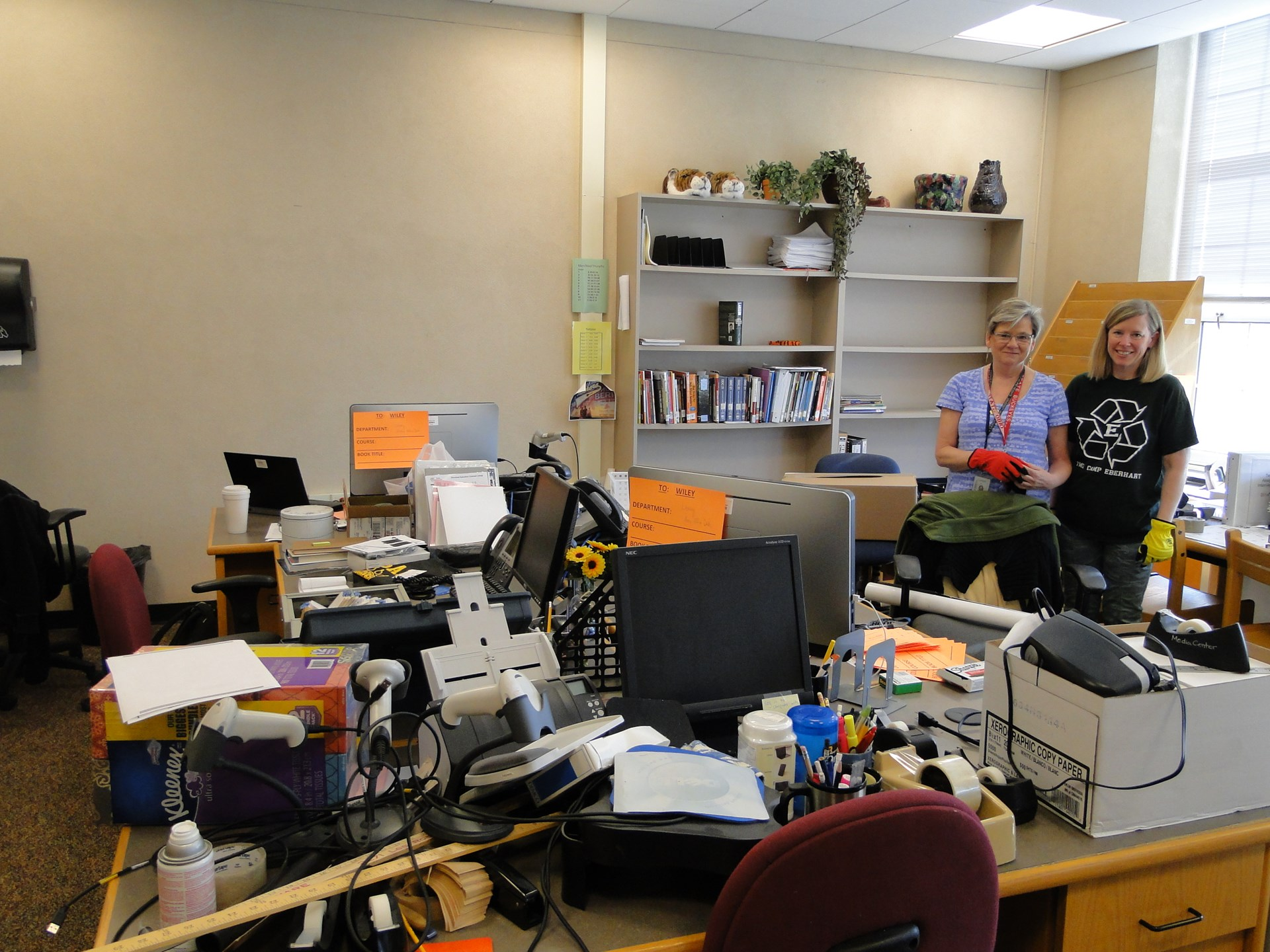 Librarians Kathy Lawrence and Amy Bloomberg (L-R) pack their office and so much more.