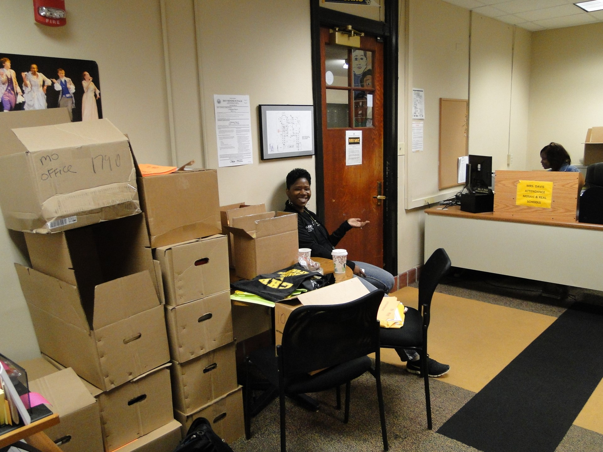Faith Gordon among the many boxes in the Mosaic office.