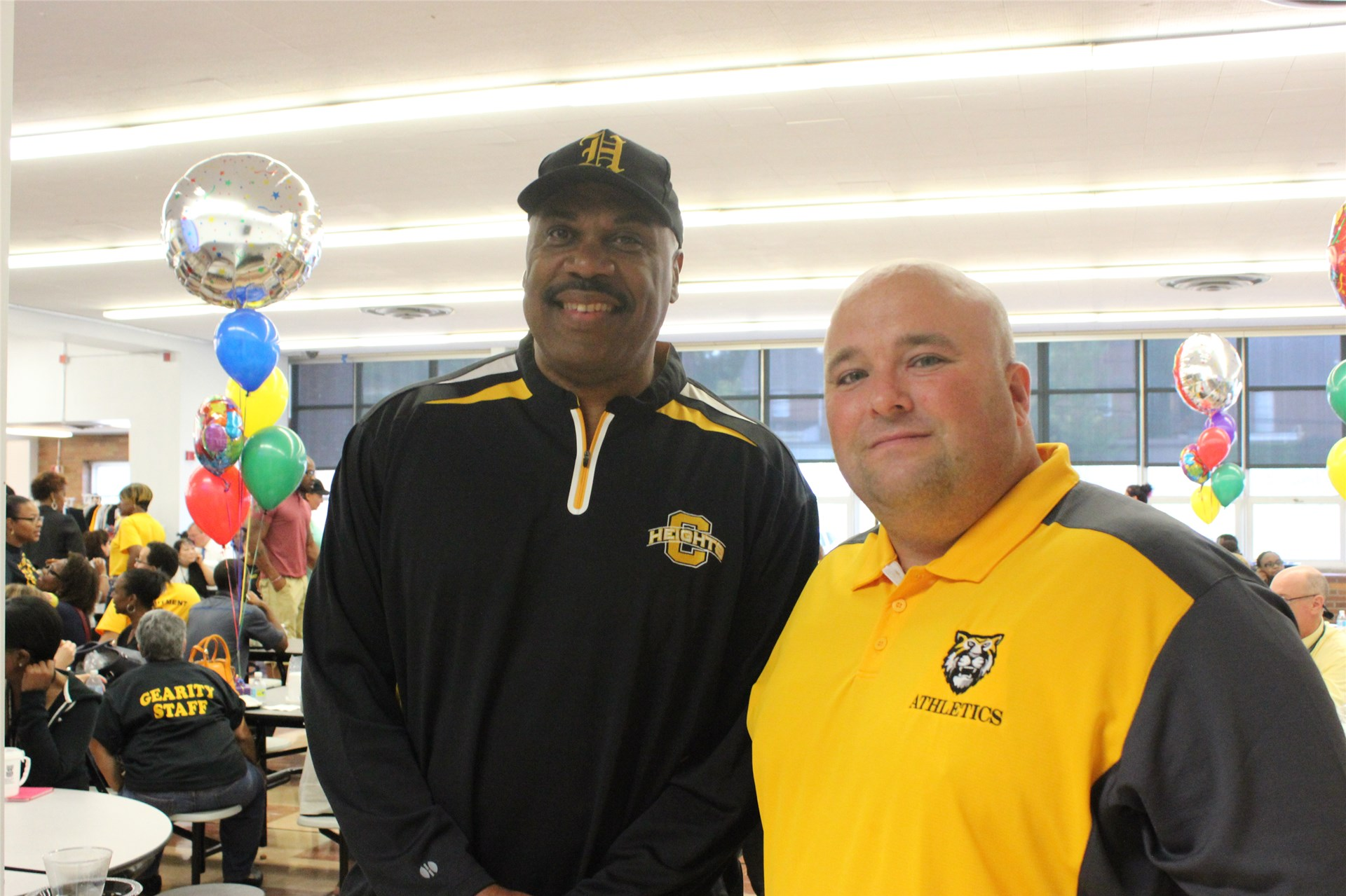 Heights High Supervisor of Athletics Dwight Hollins and Teacher Sean Evans