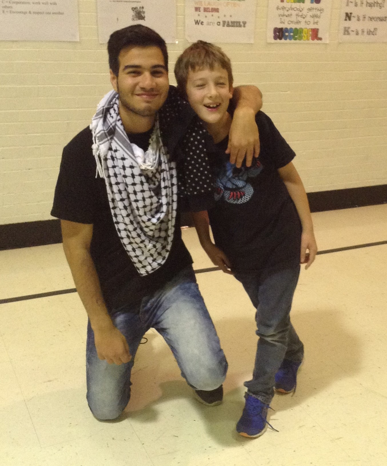 AFS Student from Palestine sees his host brother in class