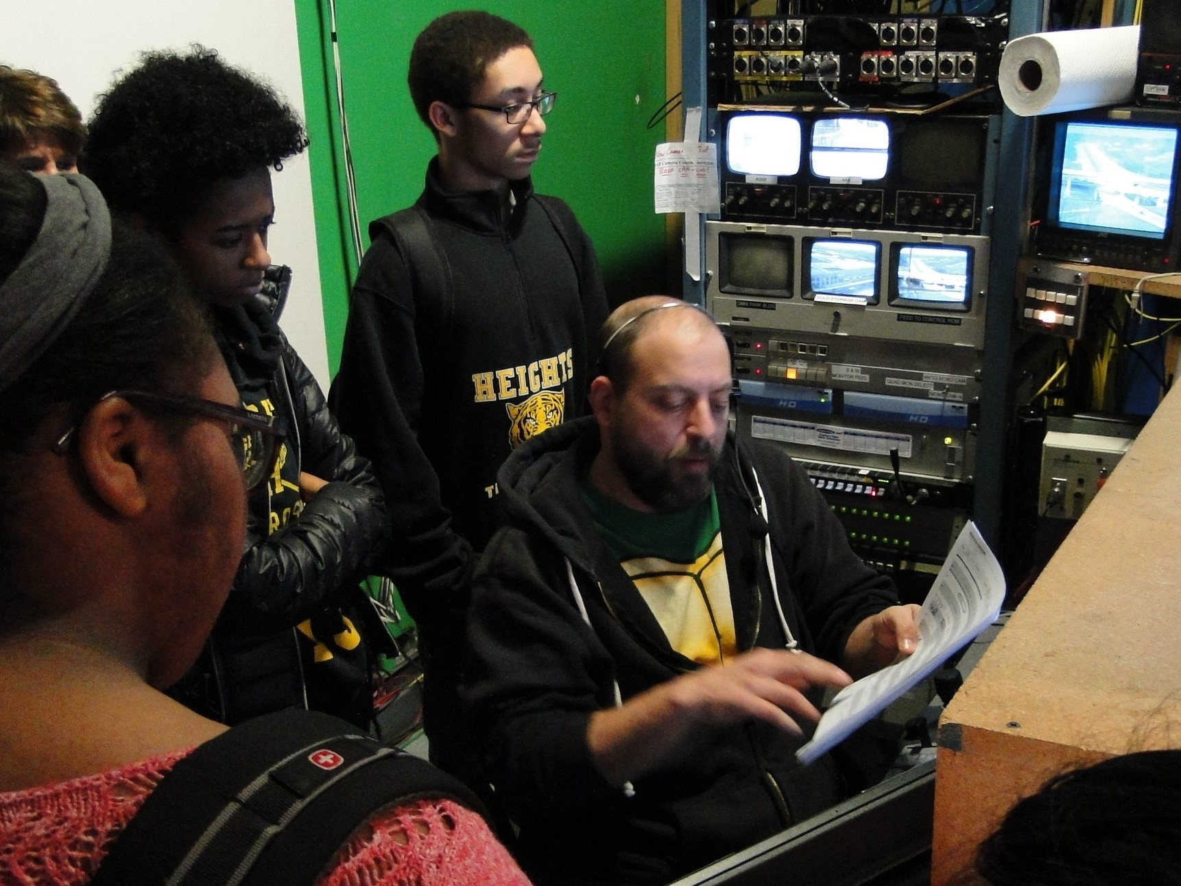 Steve Myerson is the Camera Robotics Operator & Audio Controller - he is explaining his role to students.