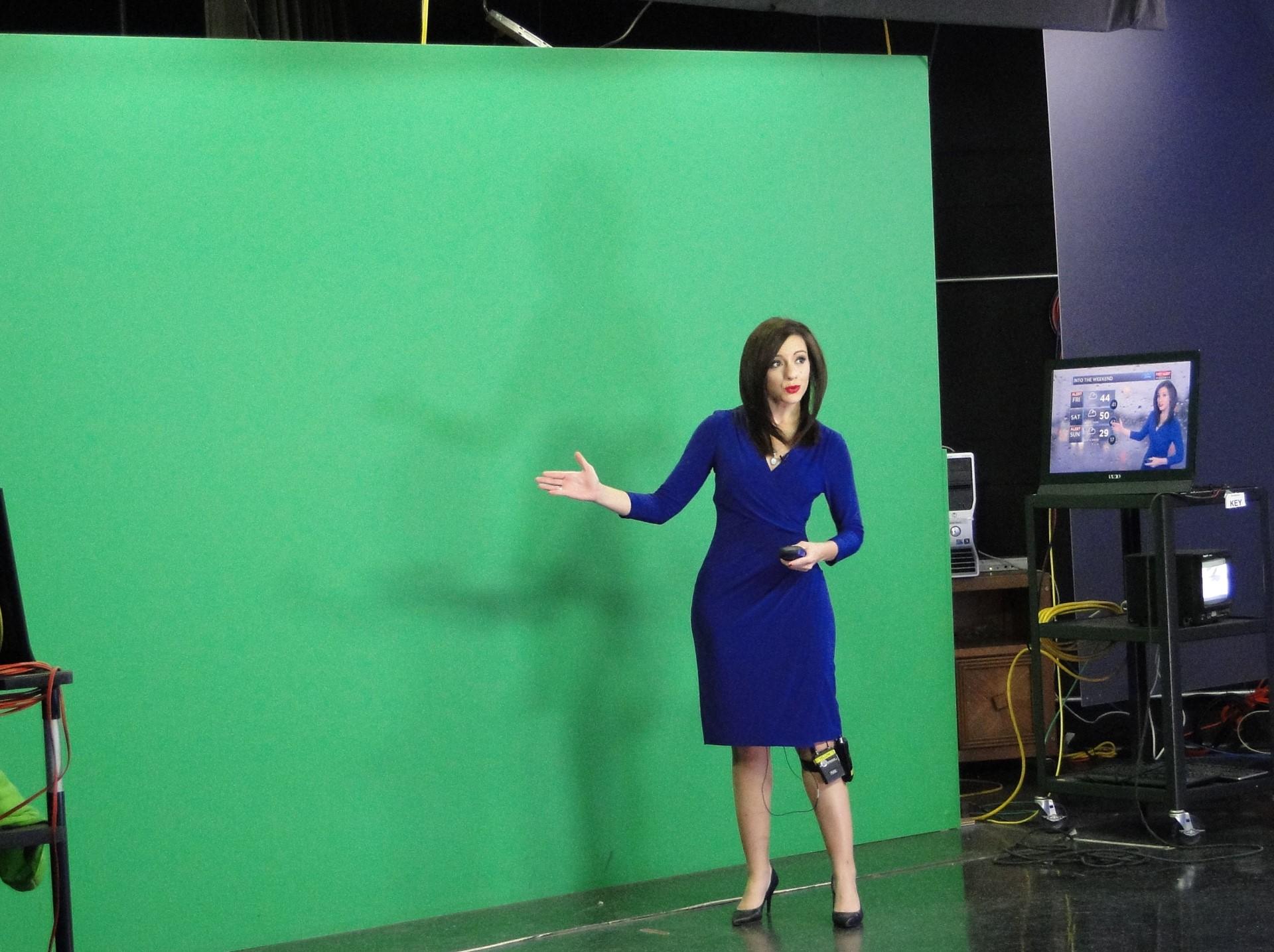Meteorologist Samantha Roberts at green screen.
