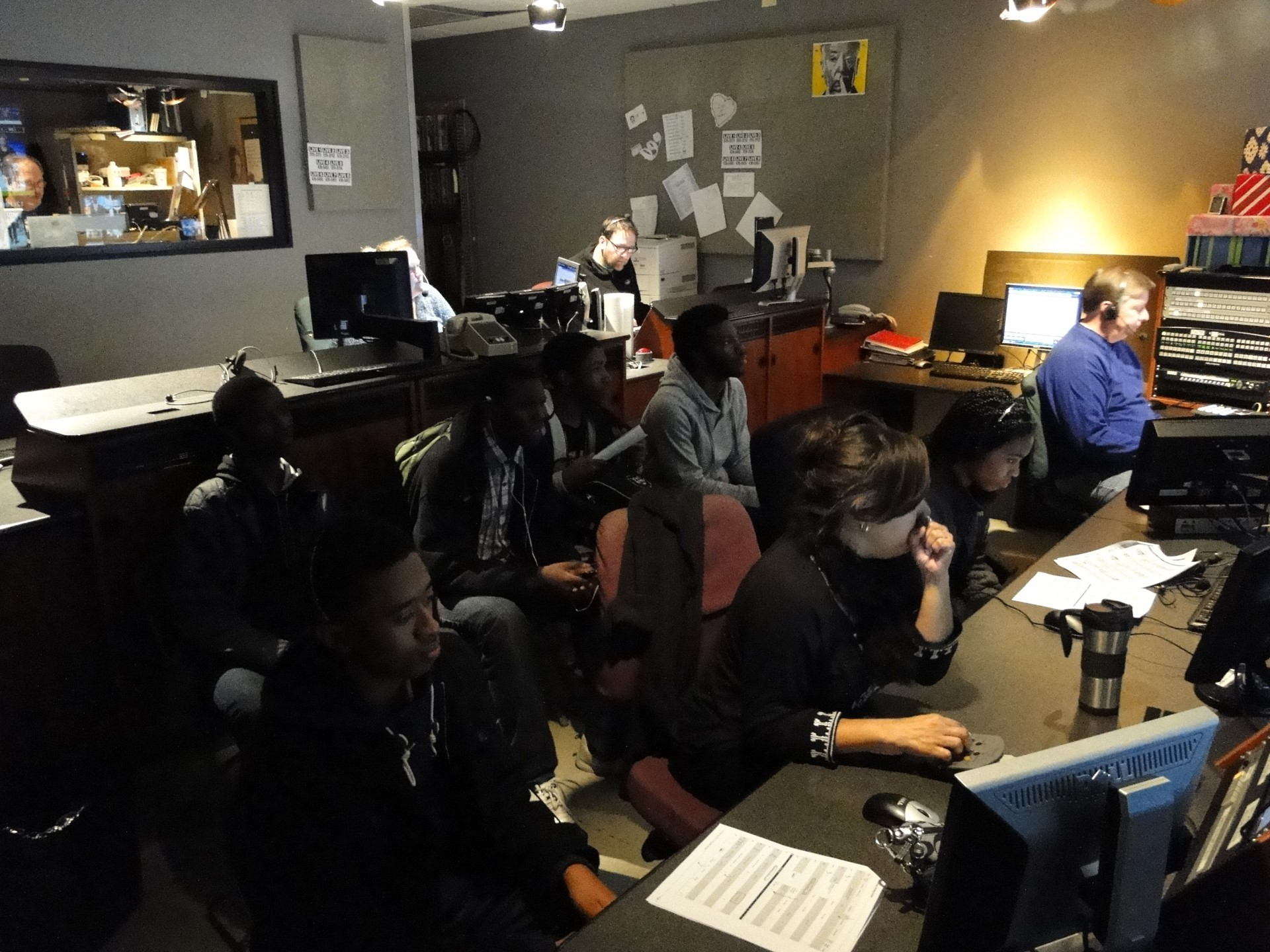 Students observing the action in the control room.
