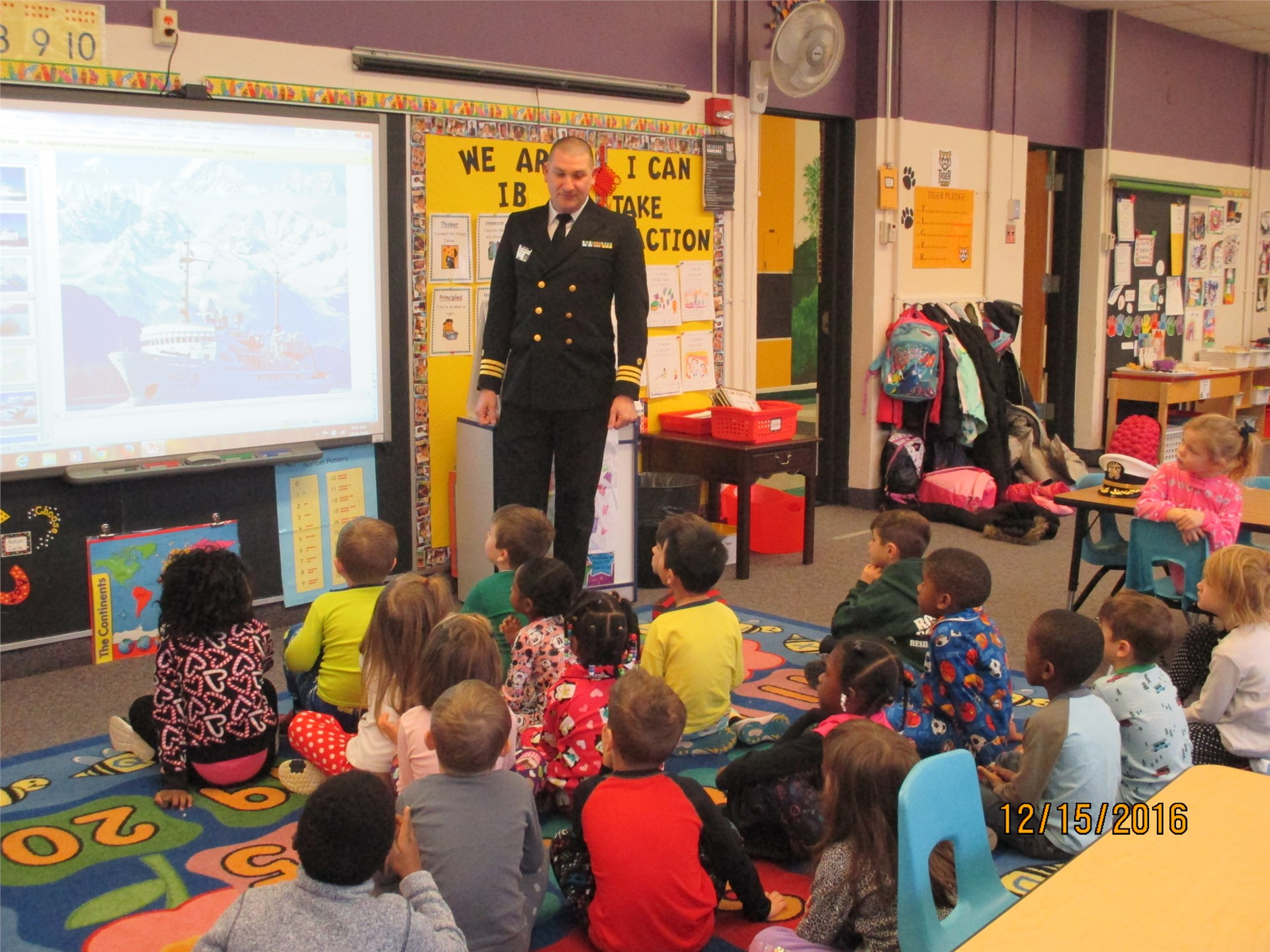 On leave from a government research ship, Commander Jay Lomnicky visits kindergarten daughter's